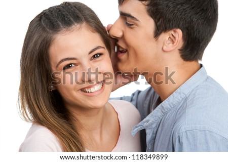 Close up of boyfriend whispering secrets to girlfriend. Isolated on white.