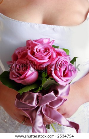 close up of brides bouquet. Beautiful colorful roses and lavender ribbon.