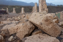 Close up of briks fallen from a wall in contruction after the strong calima wind.