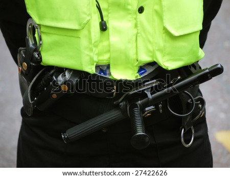 Close-up of British policeman wearing protection equipment
