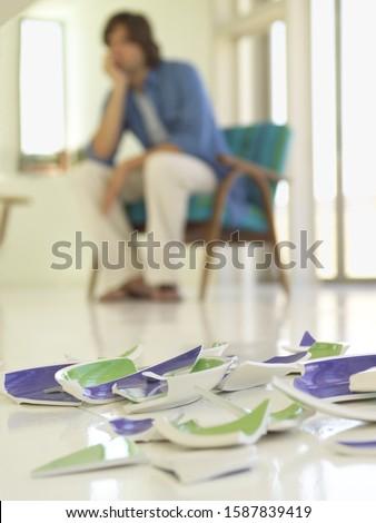 Close up of broken dish on floor