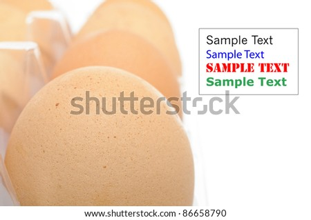 Close up of brown eggs isolated on white background (with space for text)