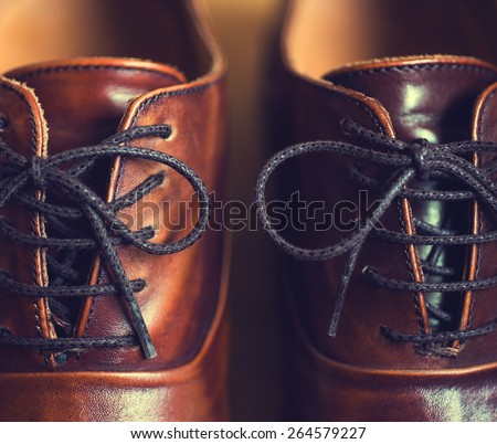 Close up of brown leather men\'s shoes