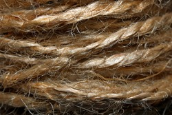 Close-up of brown threads. Woolen thread texture