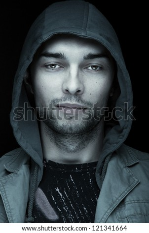 Close up of Brutal handsome man on the black background/Close up of Brutal handsome man