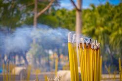 Close up of Buddhist prayer sticks burning in the censer in Po Lin Monastery, Lantau Island in Hong Kong