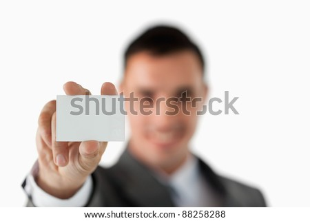 Close up of business card being shown by businessman against a white background