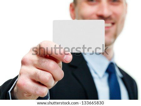 Close-up of business card in business man's hand
