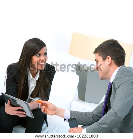 Close up of Business couple at meeting using digital tablet.