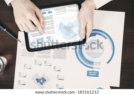 Close-up of business documents concept pointing digital tablet