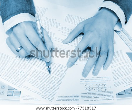 Close-up of business hands over papers