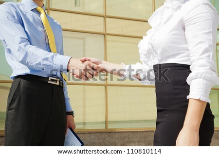 Close-up of business handshake: partners making agreement