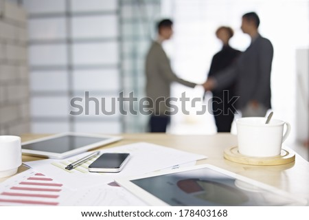 close-up of business items with people meeting in background. Photo stock ©
