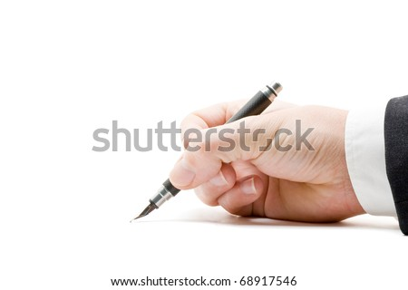 Close up of business mans hand signing paperwork with fountain pen