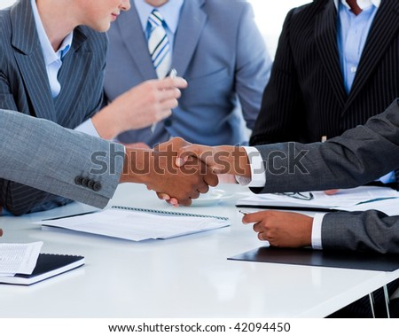 Close-up of business people greeting each other in a meeting