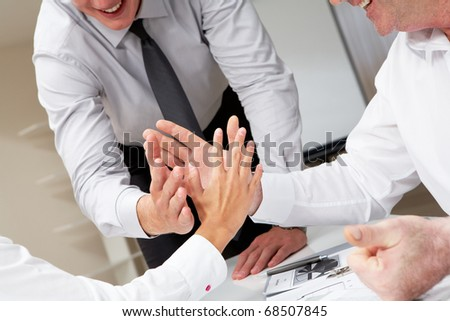 Close-up of business people palms opposite each other symbolizing support and unity