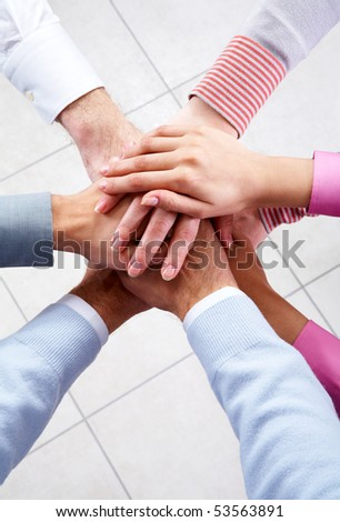 Close-up of business people?s hands on top of each other