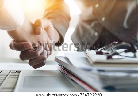 Close up of Business people shaking hands, finishing up meeting, business etiquette, congratulation, merger and acquisition concept Stock photo ©