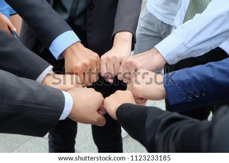 Close up of business people standing around and  handful together, successful team and,teamwork concept,selective focus,copy space. #1123233185