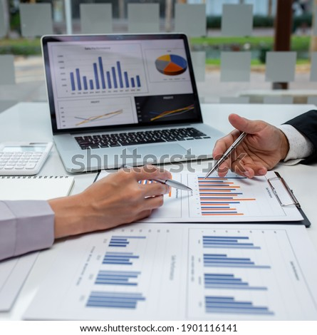 Close up of Business team analyzing income charts and graphs with modern laptop computer. Business analysis and strategy concept.