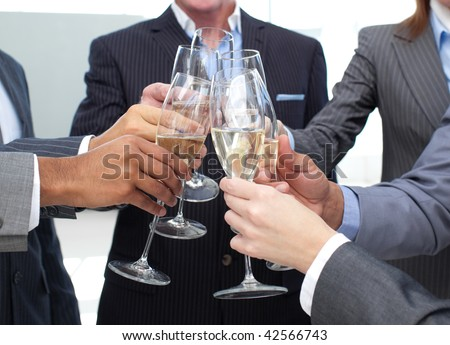 Close-up of business team toasting with Champagne in the office - stock photo
