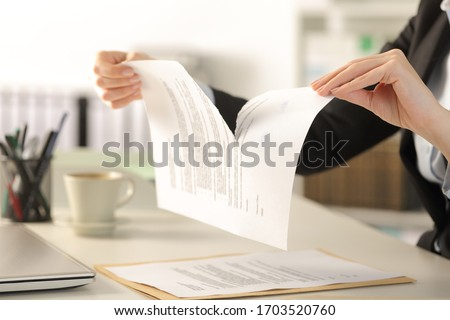 Close up of business woman hands breaking contract document sitting on a desk at the office Foto stock ©