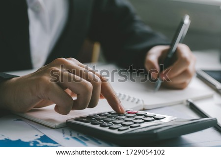Close up of businessman accountant or banker making calculations.Business Financing Accounting Banking Concept