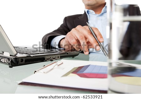 Close-up of businessman hand holding pen while working