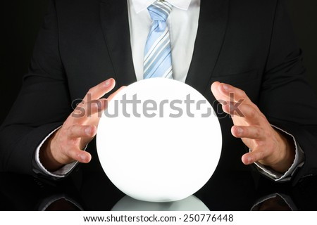 Close-up Of Businessman Hand On Crystal Ball #250776448