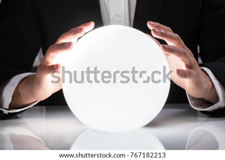 Close-up Of Businessman Hand On Crystal Ball #767182213