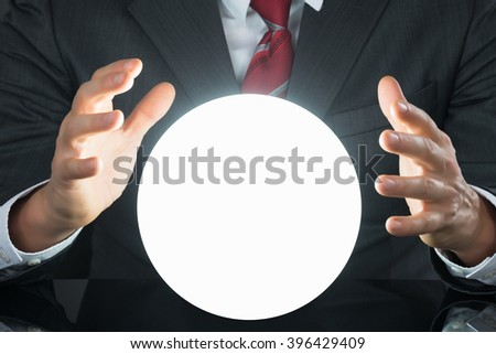 Close-up Of Businessman Hand On Crystal Ball On Desk #396429409