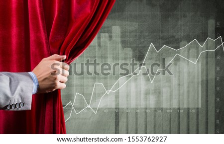 Close up of businessman hand open red velvet curtain to infographs #1553762927