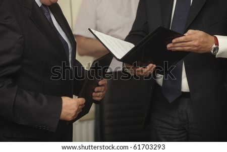 close up of businessman hands with contracts