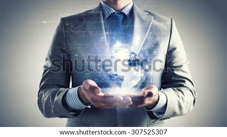 Close up of businessman holding digital globe in palm