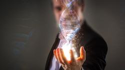 close up of Businessman holding glowing DNA helix with energy sparks - business, creation, genetics, future and science concept