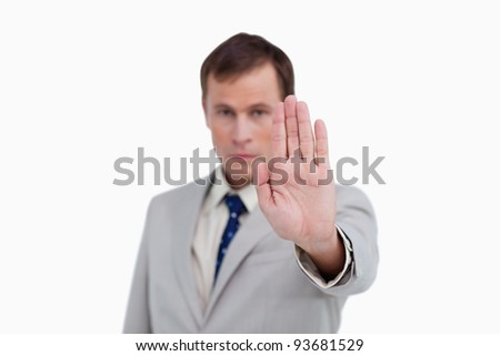 Close up of businessman's palm signalizing stop against a white background