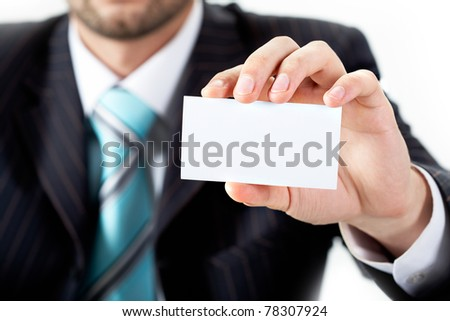 Close-up of businessman showing blank visiting card in his hand