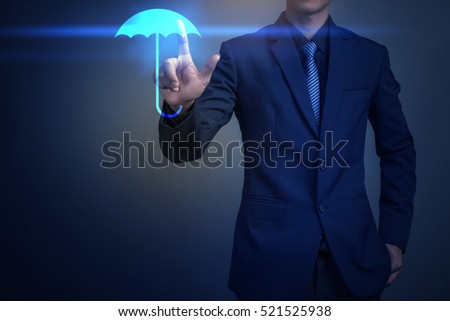 Close up of businessman touching umbrella icon, business security concept
