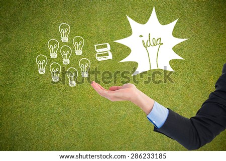 Close up of businessman with empty hand open against green background #286233185