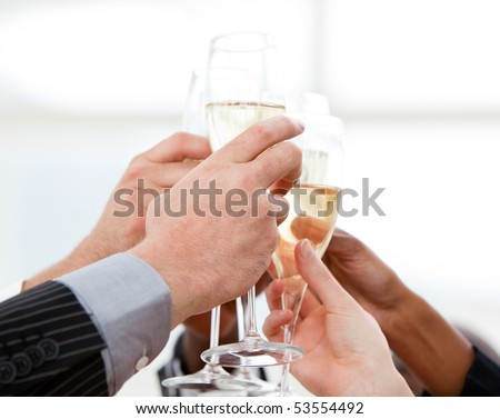 Close-up of businessmen celebrating an event with champagne in the company