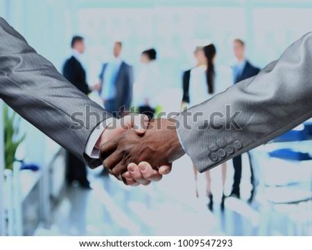 Close up of businessmen shaking hands. - Shutterstock ID 1009547293