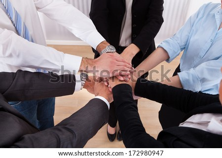 Close-up Of Businesspeople Putting Their Hands On Top Of Each Other #172980947