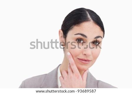 Close up of businesswoman in thinkers pose against a white background