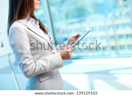 Close-up of businesswoman working with touchpad in office