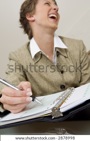Close up of  businesswoman writing in planner