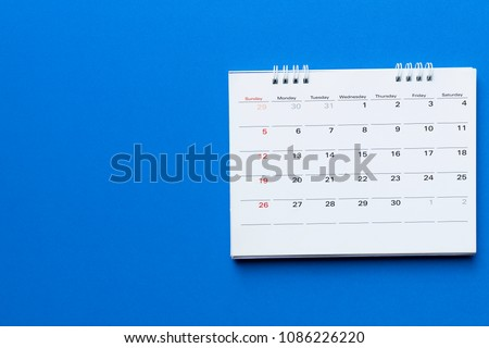 close up of calendar on blue background planning for business meeting or travel planning concept #1086226220