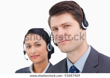Close up of call center employees against a white background