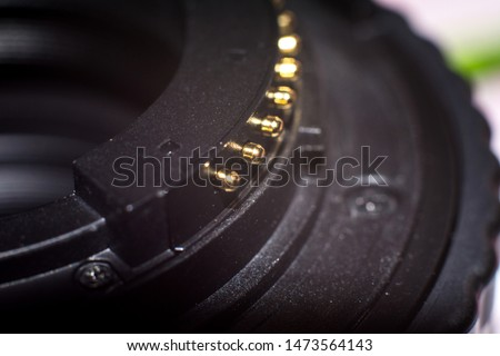 Close up of camera lens mount and lens contacts.