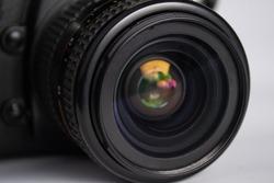 close up of camera photo lens on white background