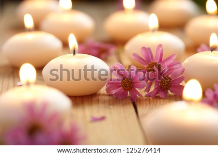 Close-up of candles and flowers